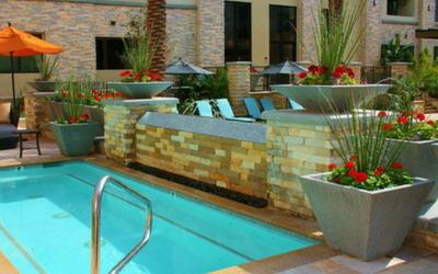 Outdoor concrete planters for apartment buildings