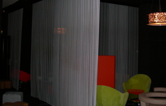 Architectural mesh divider panels at lounge