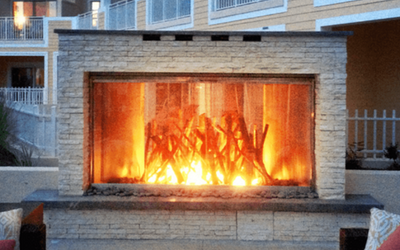 A custom fireplace door on a resort's large, outdoor fireplace
