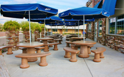 Concrete tables and benches are the way to go with outdoor dining if you want your outdoor seating to last
