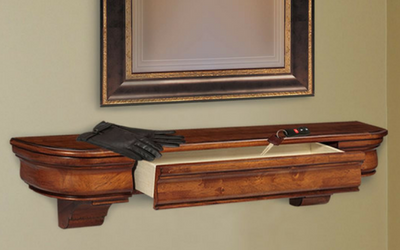 This traditional mantel shelf also has a drawer for storage