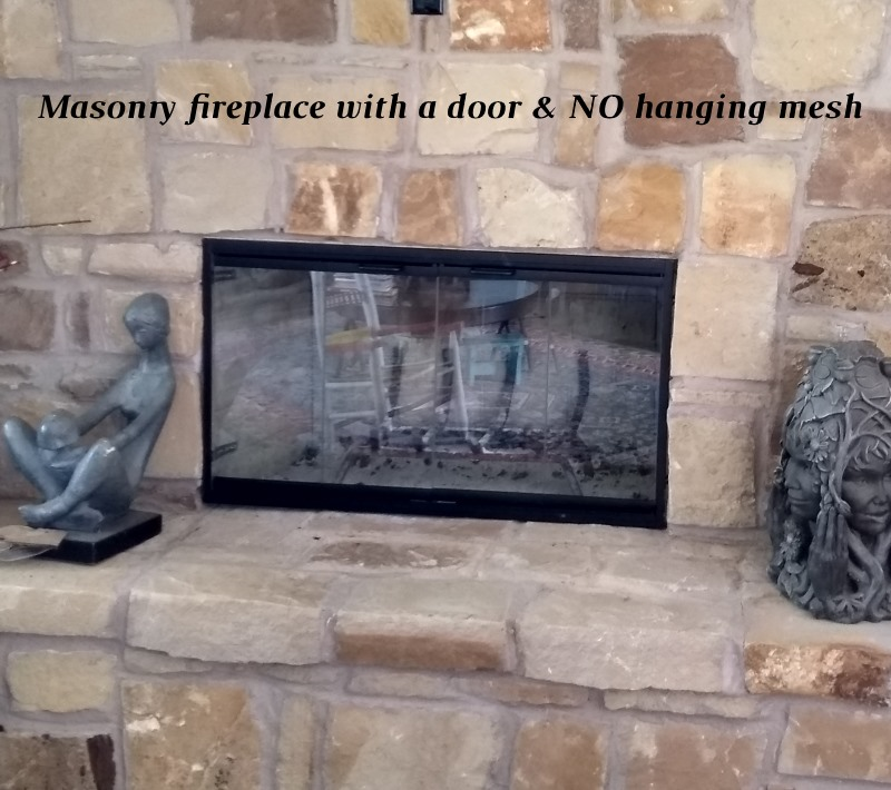 Masonry fireplace with a door and no hanging mesh