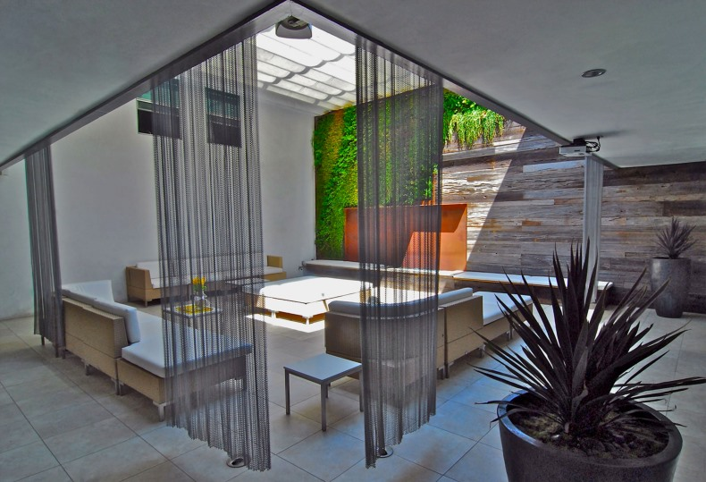 Use architectural mesh panels to close off an outdoor room!
