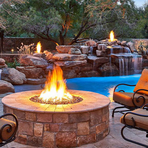 Outdoor Fire Pit next to poolscape