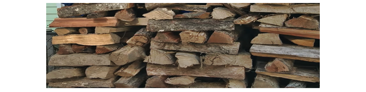 Crisscrossed stacked firewood.