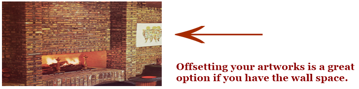 Offsetting artworks above a fireplace to protect them from the heat of the fireplace.
