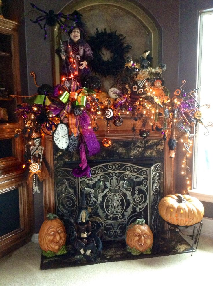 Halloween is, if anything, over the top! Check out this loud and extravagant Halloween mantel decor!