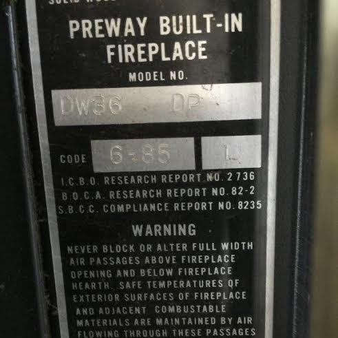 Prefab fireplaces have a manufacturer's tag.