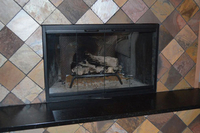 The Pelham zero clearance fireplace door can fit into any surrounding!