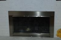 Customer photo of a slimline fireplace door