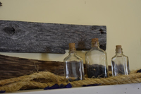 Pallet wood, rope, and glass bottles.