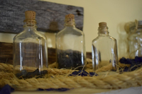 Glass bottles with corks.