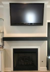 Happy customer's custom length steel mantel shelf in black matte powder coat finish.