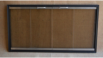 Northline Zero Clearance Fireplace Door shown in Flat Black With Stainless Glass Channels and Handles