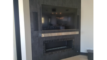 Happy customer's finished project with the Brushed Stainless Steel Mantel Shelf!