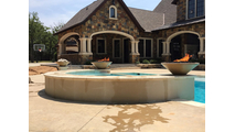 31 Inch Brown Cadiz Fire Bowls in a poolscape