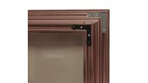Avaleria fireplace door double corner brackets - door shown in anodized Vintage Copper