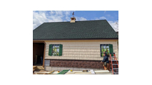 """48""""W Cascade Stacked StoneFaux Siding Panel Front of House View"""