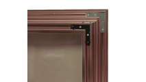 Huntress fireplace door double corner brackets - door shown in anodized Vintage Copper