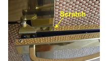 Scratch on door stile