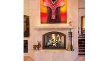 Heritage full arch masonry fireplace enclosure with trackless bi-fold doors (Old Copper finish)