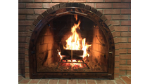 A real customer photo of their Full Arch Fireplace Door!