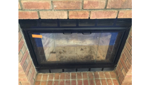The Nightwell Fireplace Door in matte black for prefab fireplaces - March 2018 customer installation!