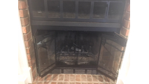 Carolina Arch Conversion ZC fireplace door offers bi-fold doors.