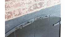 Top mounted handles on the Forged Steel Laramie Arch Conversion masonry fireplace door