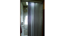 Surround yourself in luxury with this mesh shower curtain in Brite Pearl Grey!