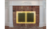Installed Ovation Fireplace Door shown in Satin Brass with deco design