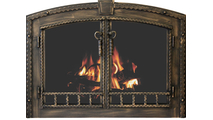 Denali Arched masonry fireplace door shown in Burnished Copper premium finish