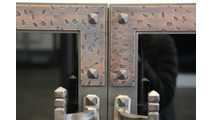 Rivets and banding are highlights of the ancient masonry fireplace door