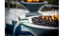 31 Inch Black Cazo Pool Fire Bowl in Poolscape Setting