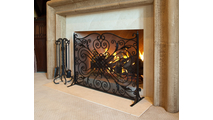 Wrought Iron Panel Screen in Use Alongside Matching Tool Set