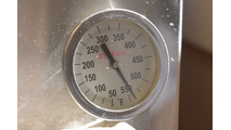 Closeup of thermometer gauge on the 48 Inch Profire Built-In Grill Head