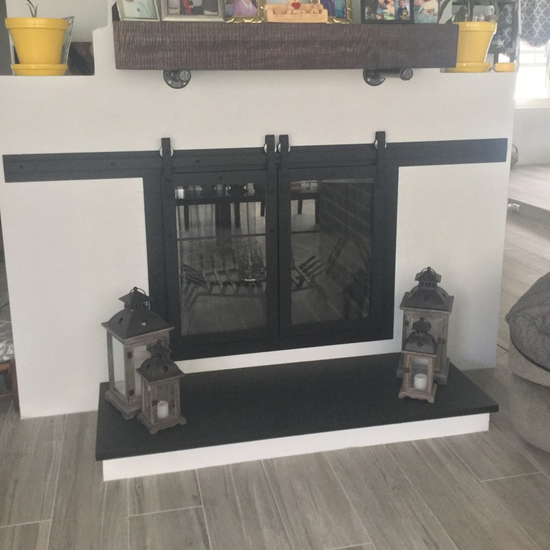 Custom Paterson sliding door for a customer's see through masonry fireplace - opposite side!