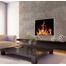 Installed hidden frame Broadway zero clearance fireplace door in Polished Nickel